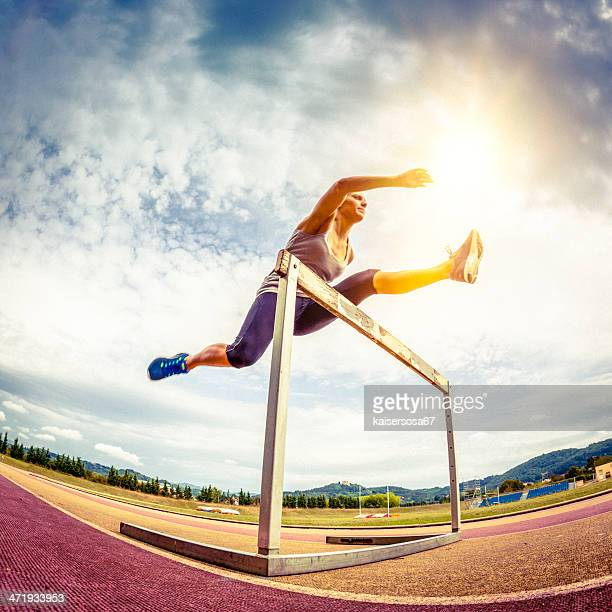 Female competitor jumping the steeplechase obstacle