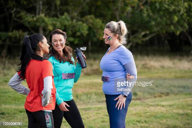 female competitors talking together at outdoor event - competition group stock pictures, royalty-free photos & images