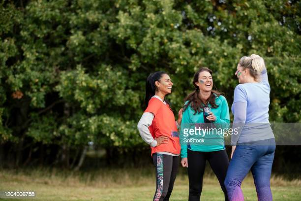 female competitors together at outdoor charity event - competition group stock pictures, royalty-free photos & images