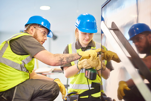 female construction apprentice and colleague 509029388