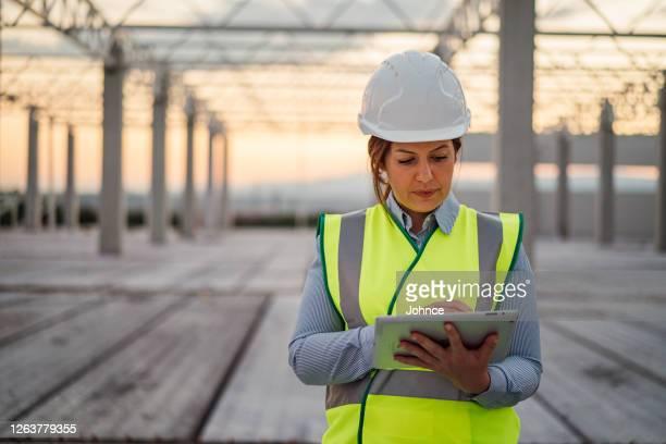 female construction engineer using tablet - health and safety stock pictures, royalty-free photos & images