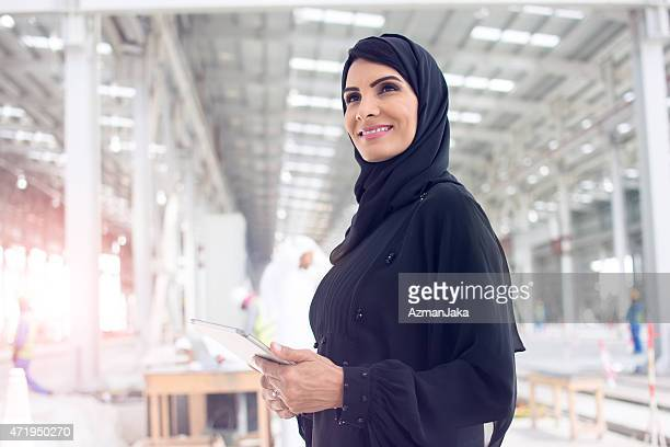 female construction manager is happy with construction - united arab emirates stock pictures, royalty-free photos & images