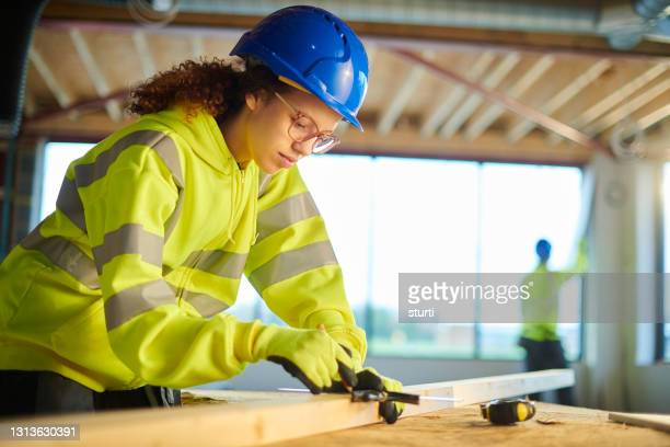 female construction trainee - stem stock pictures, royalty-free photos & images