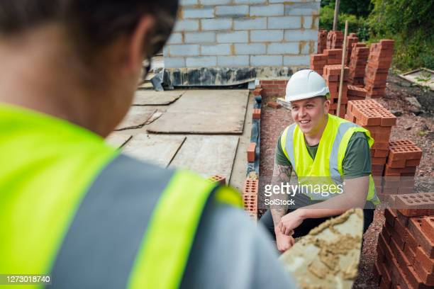 female construction worker at work - construction industry stock pictures, royalty-free photos & images
