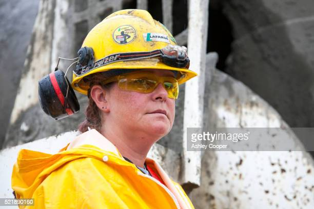 A female Construction worker building new houses in Fort McMurray to house tar sands workers.
