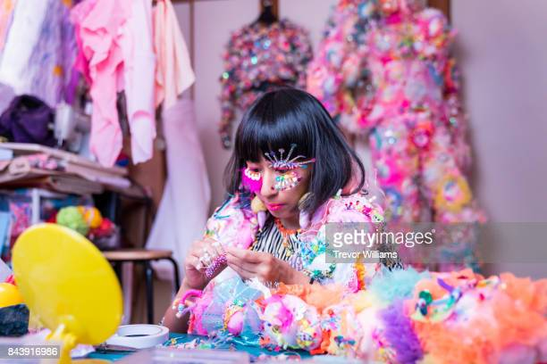 A female contemporary artist dressing up in colorful fashion