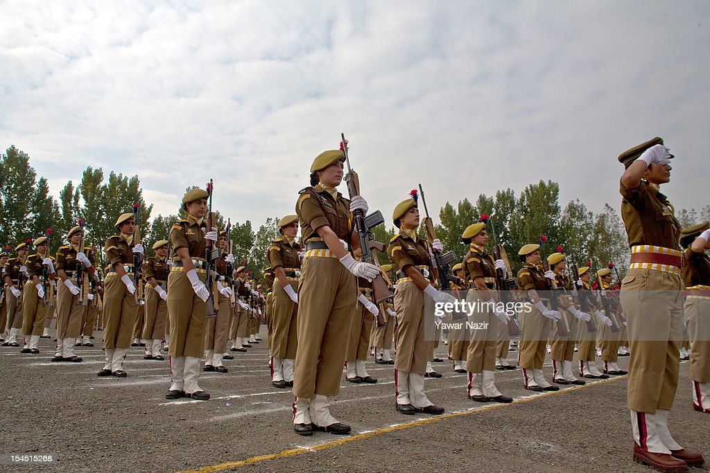 A female contingent of Indian police offers salute to Omar Abdullah chief minister of state (not in frame) during a ceremony on police Commemoration Day on October 21, 2012, in Zewan, on the outskirts of Srinagar, the summer capital of Indian administered Kashmir, India.To pay homage to the slain Indian policemen and security forces killed in the militant attacks in the strife- torn region of Kashmir during the last two decades, the annual Police Commemoration Day is observed to remember on 21 of October .