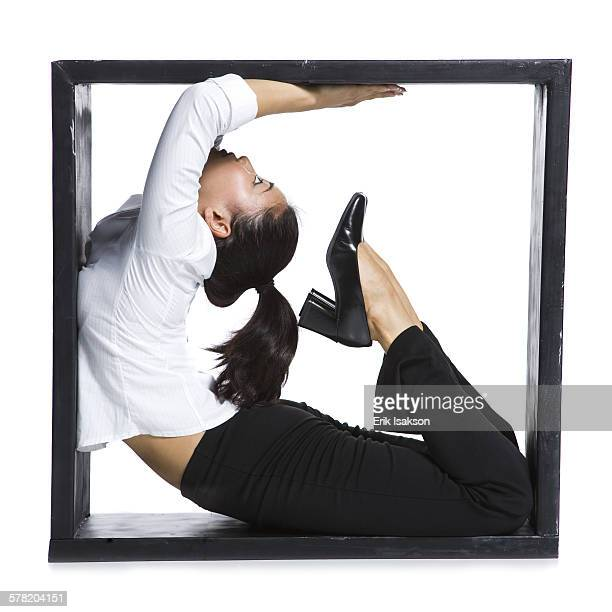Female contortionist businesswoman inside the box