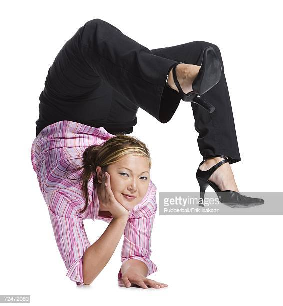 female contortionist businesswoman - contortionist stock photos and pictures