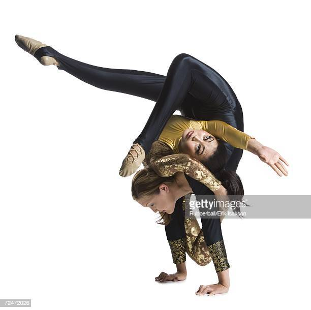 female contortionist duo performing - contortionist stock photos and pictures