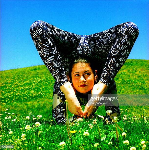 Female contortionist in field