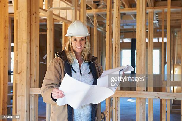 Female contractor with blueprints