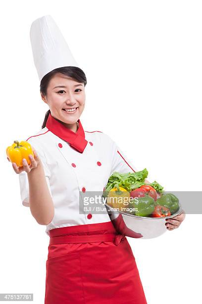 female cook with bell pepper - たらい ストックフォトと画像