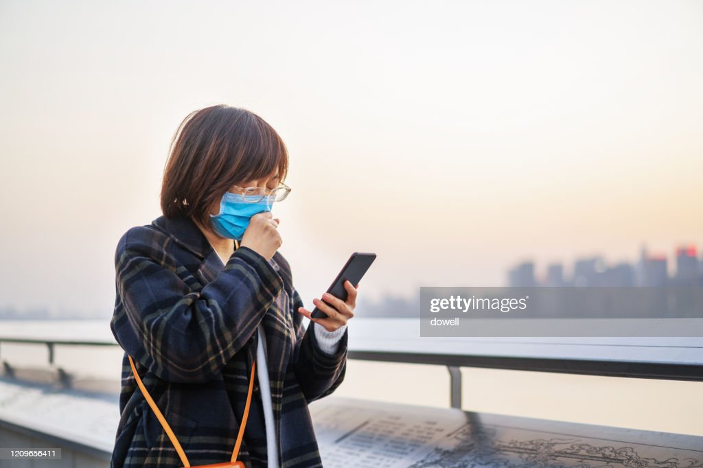 female cough with using mobile phone : Stock Photo