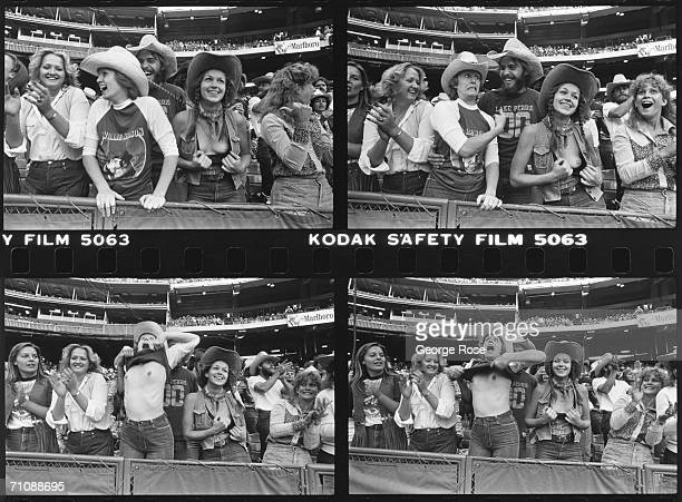 Female country western music fans flash their breasts during a 1980 Willie Nelson concert at Anaheim Stadium in Anaheim California