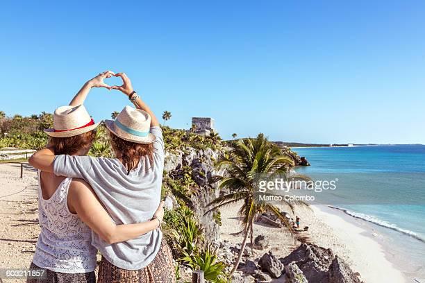 Female couple doing a heart sign, Tulum, Mexico