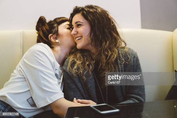 Female couple hanging out at a coffee shop