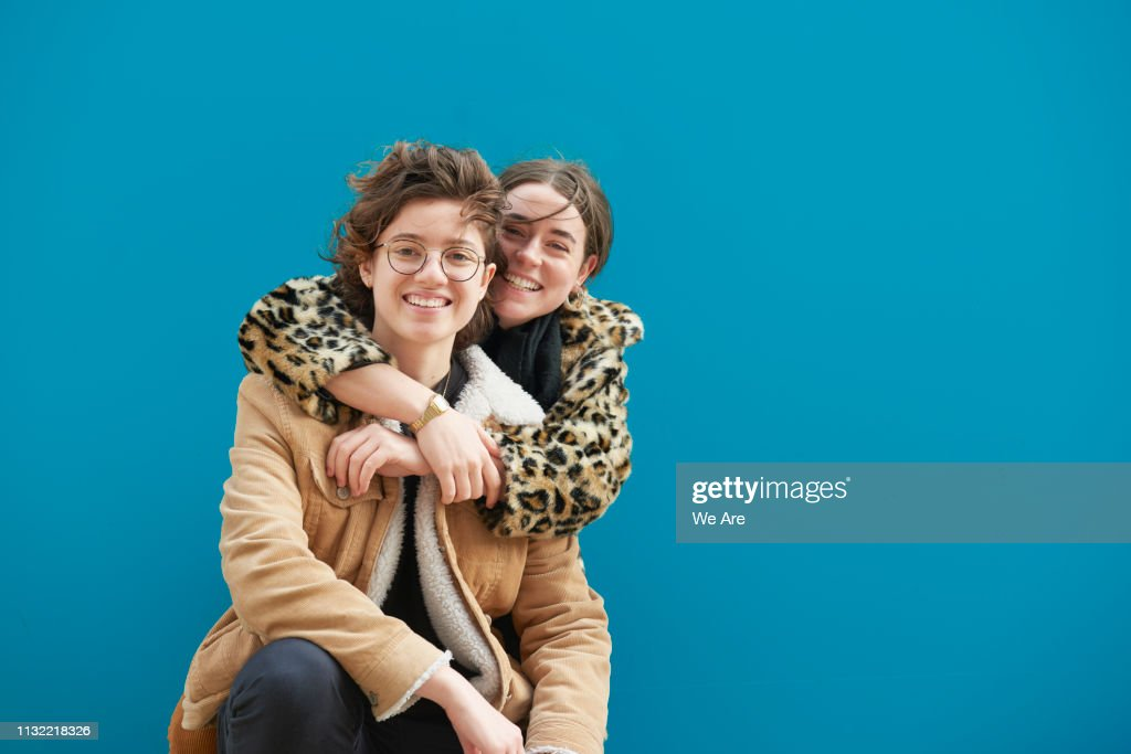 Female couple in an embrace. : Stock Photo