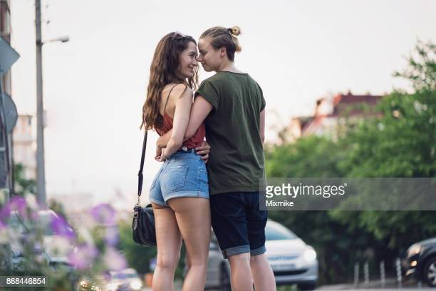 Female couple looking at each other eyes and kissing