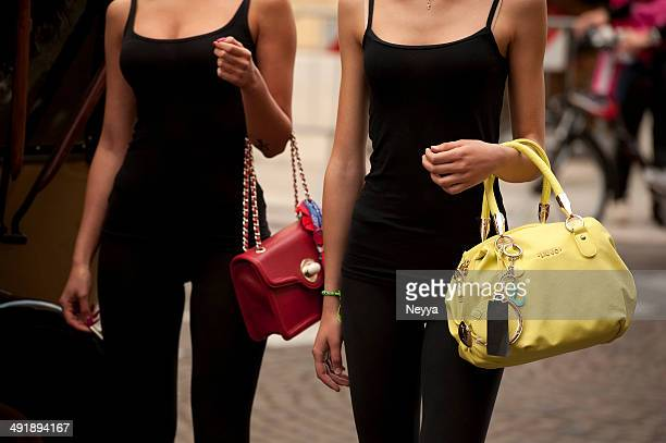 female couple on a fashion show - handbag stock pictures, royalty-free photos & images