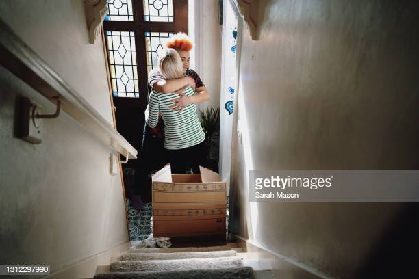 female couple standing inside door of new home - love stock pictures, royalty-free photos & images