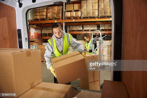 female courier filling her van