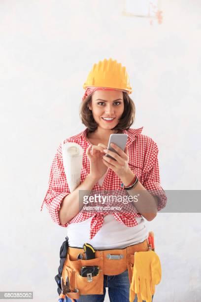 Female craftperson using smart phone