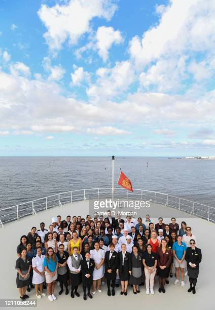 Female crew members on board Cunard's Queen Mary 2 pose for a group photo on the forward bow of the ship berthed at Station Pier on March 08 2020 in...