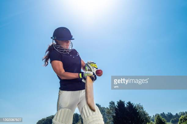 female cricket batter hitting the ball - sport of cricket stock pictures, royalty-free photos & images