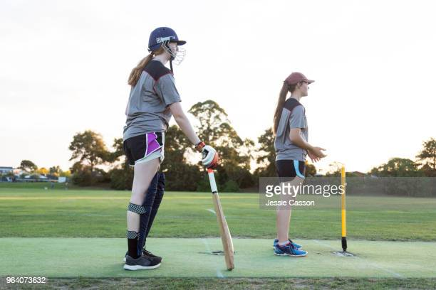 female cricket players on sports field - cricket player stock pictures, royalty-free photos & images