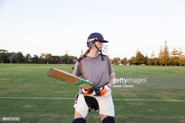 female cricketer stands with a bat - cricket player stock pictures, royalty-free photos & images
