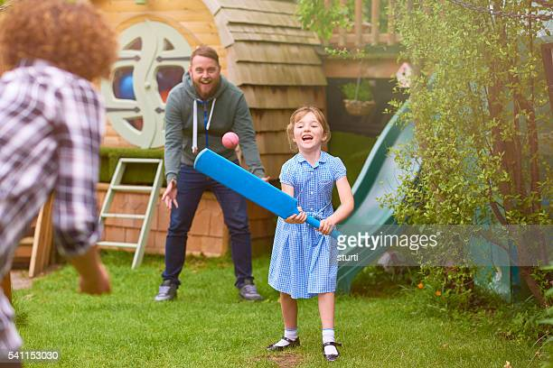 female cricketer with family in the garden