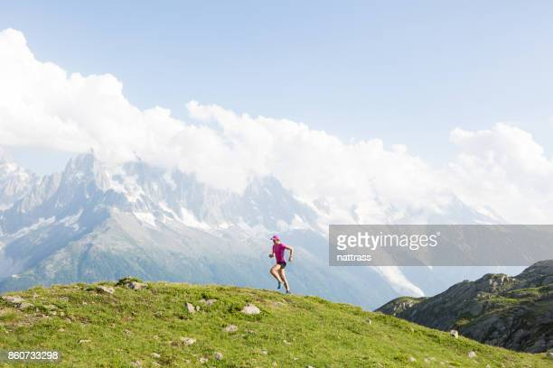 Female cross country running in the mountains
