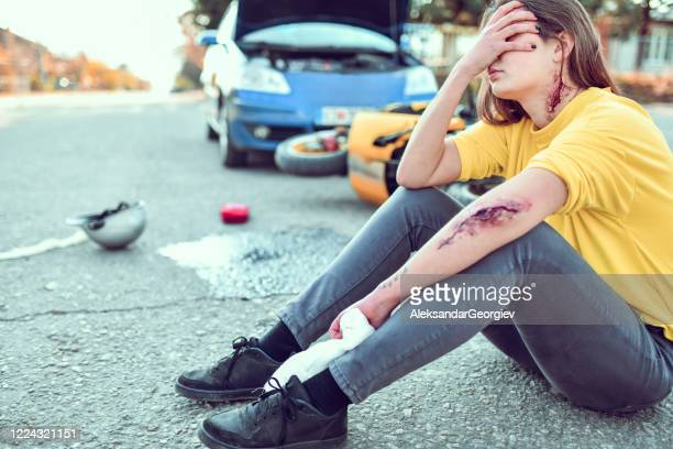 female crying, devastated after her traffic accident - gory car accident photos stock pictures, royalty-free photos & images