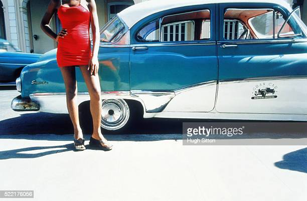 female cuban next to vintage car - hugh sitton stock pictures, royalty-free photos & images