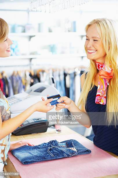 Female customer buying clothes in a clothing store