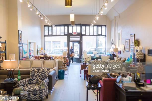 Female customer entering furniture store