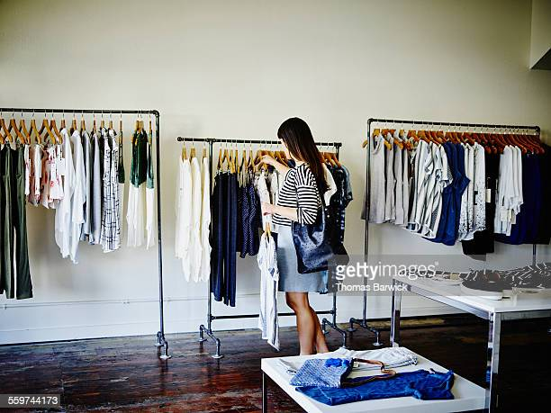 Female customer looking through rack in boutique