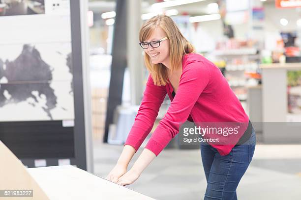 female customer opening chest of drawers in hardware store - sigrid gombert stock pictures, royalty-free photos & images