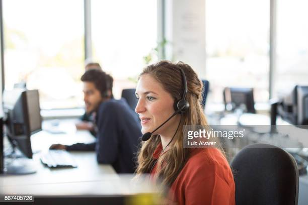 female customer representative working in office - receptionist stockfoto's en -beelden