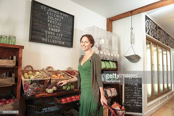 female customer shopping in country store - heshphoto stock pictures, royalty-free photos & images