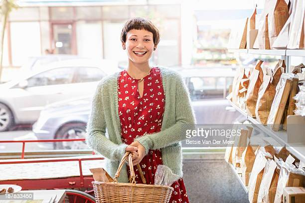 female customer shopping in deli shop.