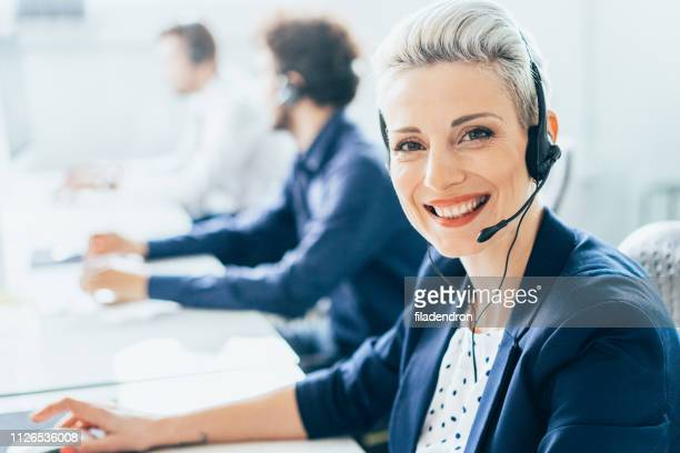 female customer support executive - contact us stock pictures, royalty-free photos & images