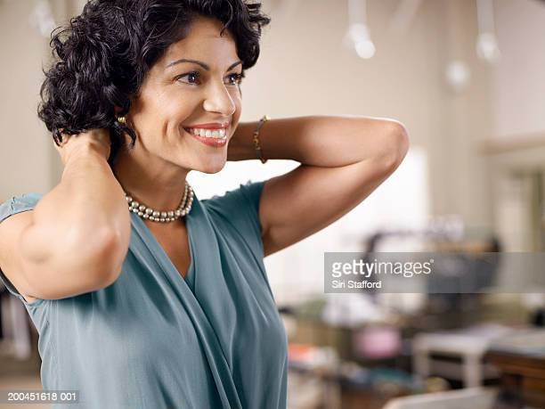 female customer trying on pearl necklace in shop - pearl jewelry stock pictures, royalty-free photos & images