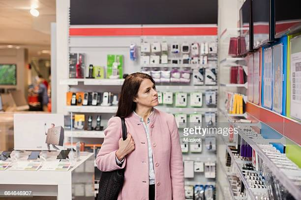 Female customer viewing television sets in store