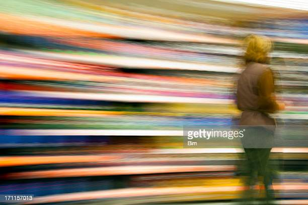 Female Customer Walking Against Colorful Background, Blurred Motion