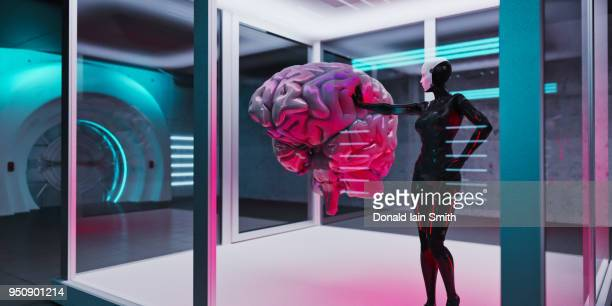 Female cyborg in futuristic room reaches out to touch oversized floating human brain