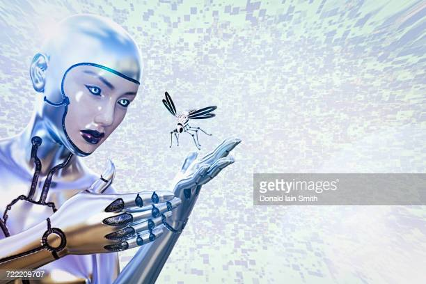 Female cyborg watching flying robot insect