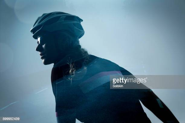 female cyclist and road, double exposure - multiple exposure sport stock pictures, royalty-free photos & images