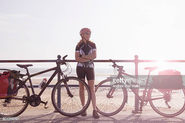 Female cyclist enjoys tour cycling along the cost